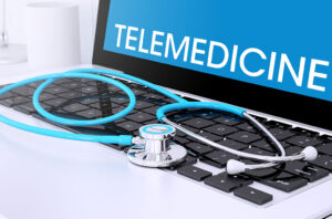 telemedicine laptop and stethoscope